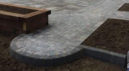 Castle grey sandstone & graphine rumbled rocks - North Essex Landscaping