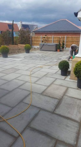 Garden patio with grey slabs