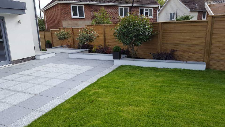 Grass and grey slabs